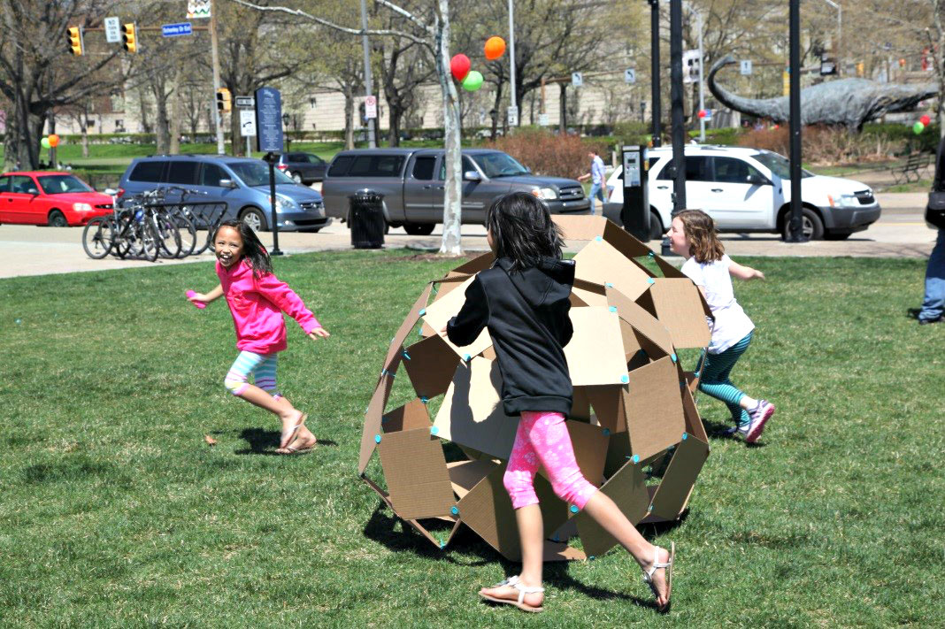 Girls rolling cardboard balls in Playful City USA Pittsburgh