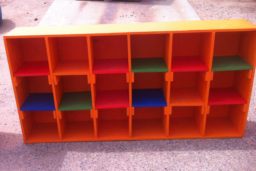 row of brightly painted storage cubbies