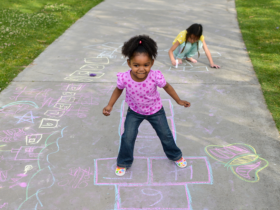 Partners Foundations Index - girl playing hopscotch