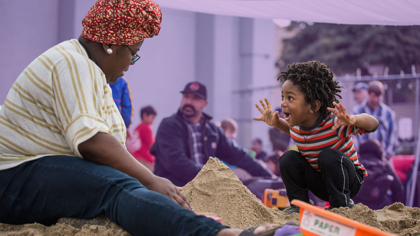 Play Matters - woman and child play in sandbox