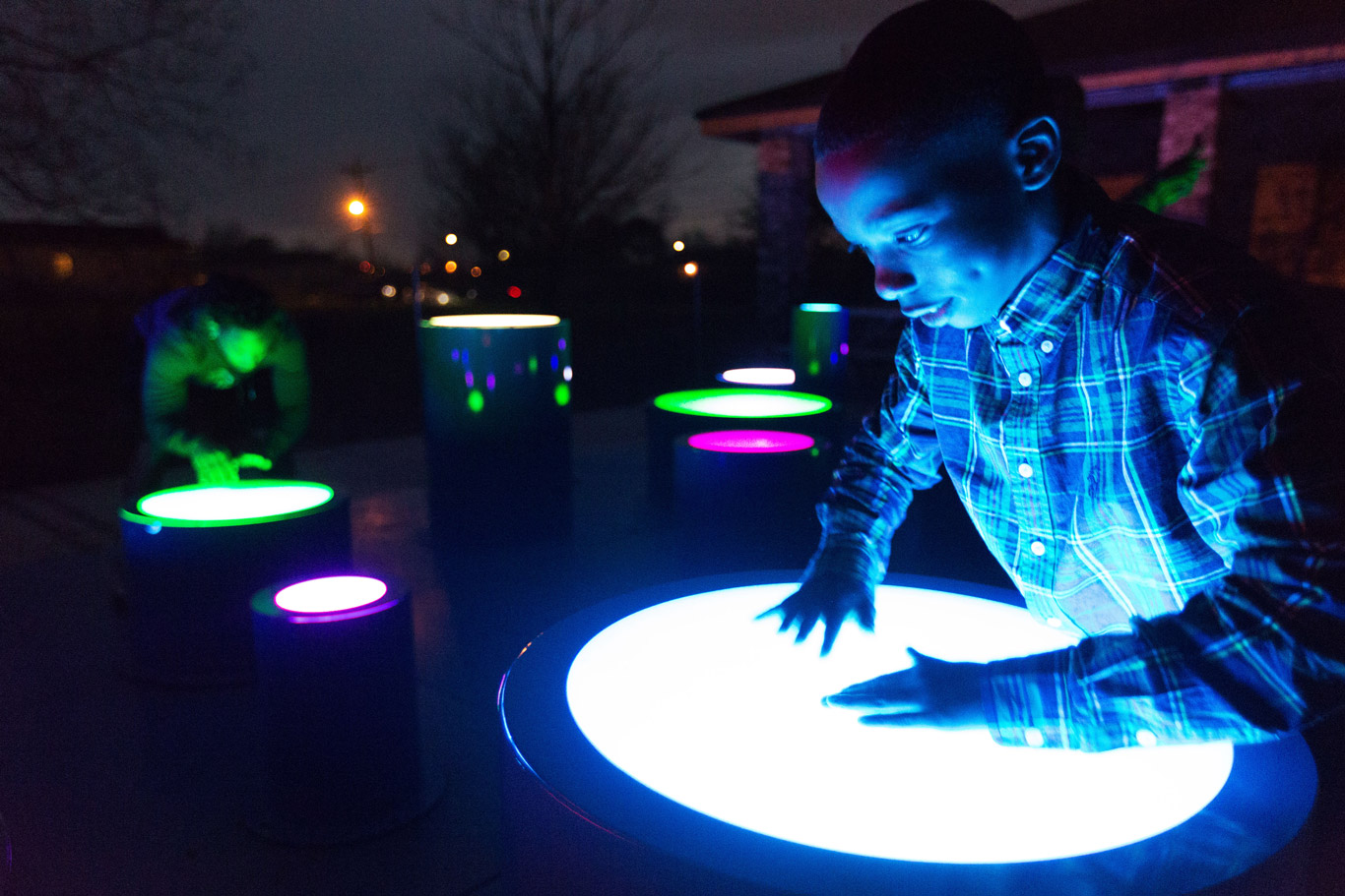 Boy plays on glow-in-the-dark drums