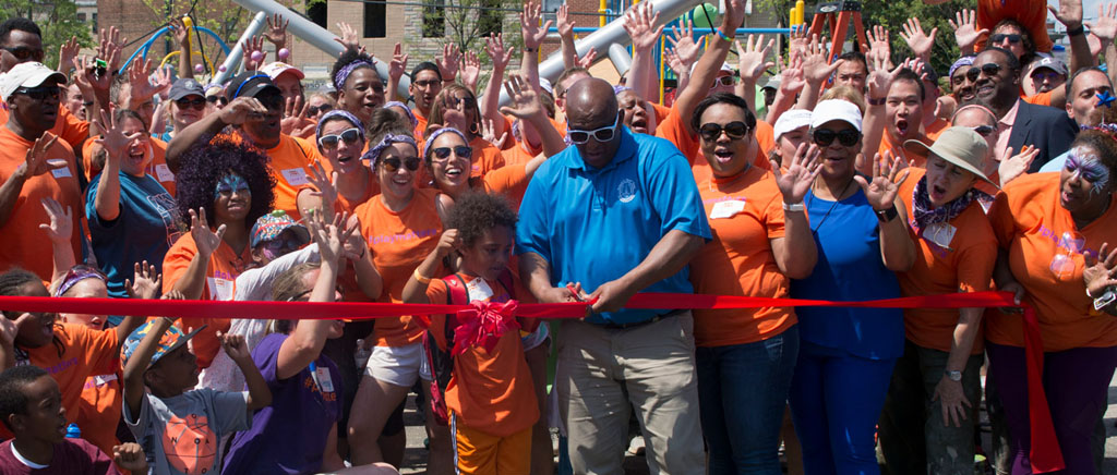 Cutting the ribbon on a new playground