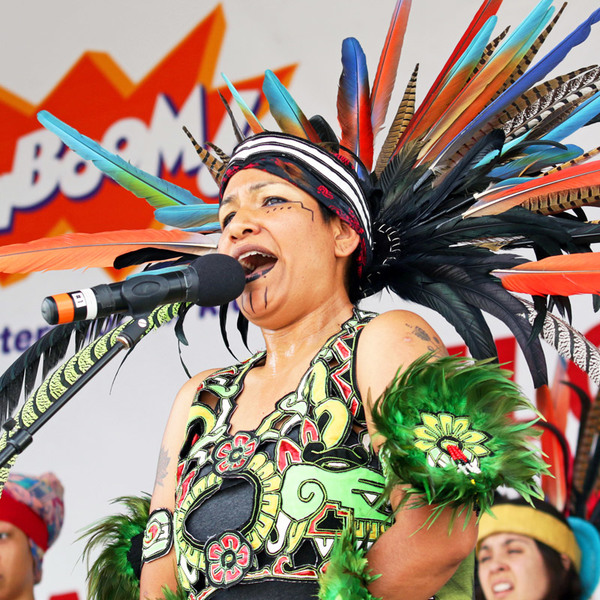 At the Play Everywhere Tour, powered by Target, a singer performs in a traditional headdress.