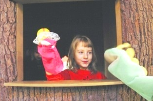 Playing with puppets in a treehouse