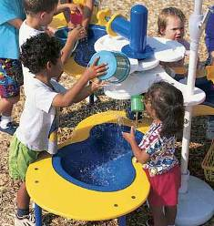 Children play with water table