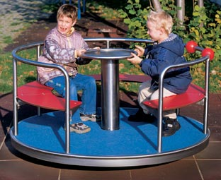 Children play on spinner