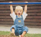 Child swings from hanging bar