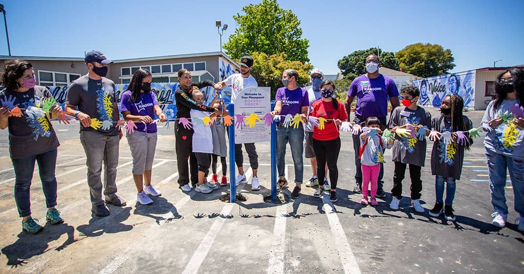 Stephen Curry and Ayesha Curry cut the ribbon to open the new playspace